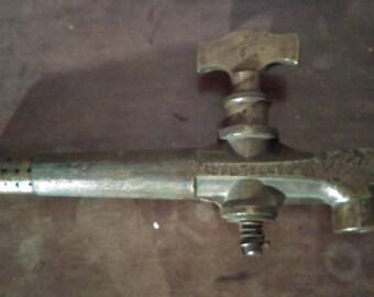 Antique brass barrel tap spigot