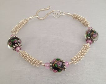 Silver wirework bracelet, with glass lampwork beads.