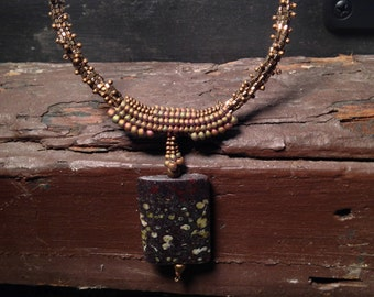Necklace: jasper and gold colored princess length beaded