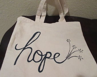 Hope is a waking Dream - Aristotle. This lovely fold out shopper bag spreads hope to the world around you. Artwork by Heather Sparkman