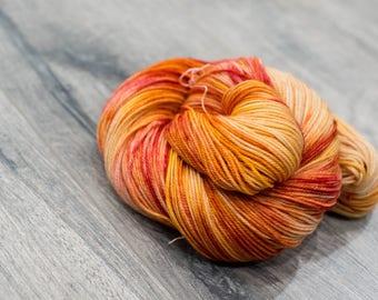 Canadian Hand-dyed sock yarn. 70/20/10 SW Merino/Cashmere/Nylon. 115g 400 yards. Ready To Ship. Sunstrider, multi-colored red orange yarn