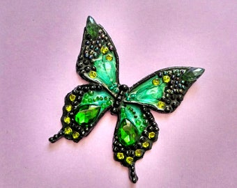 Butterfly brooch hand carved from stones and beads
