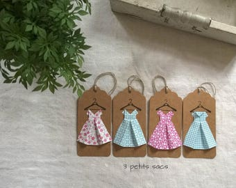 4 labels kraft paper, folding origami, shades of blue and pink dresses. vintage vibe