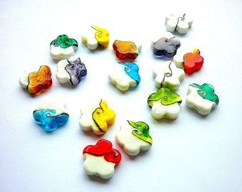 Set of 16 beautiful glass flower beads