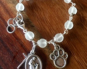 "Prayer bracelet, handmade with white frosted glass beads, small crucifix with St Francis ""Bless and protect my pet"" medallion charm"