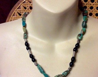 Genuine turquoise and skull beads necklace.
