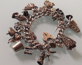 Vintage Charms bracelet, 21 charms, chain, 925 sterling silver, heart lock closure, Great Britain, vintage '60s, weight 80gr