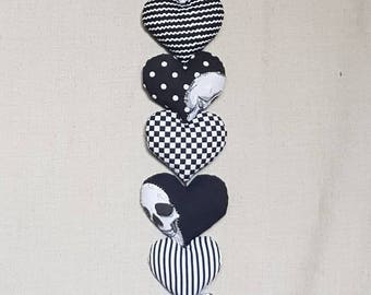 Gothic grinning skull string of 7 hearts-black and white-door hanger-mobile-wall decor-magical gothic decor-dark romance- ornament-gift.