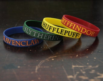 House Silicone bracelets.  Pick one.
