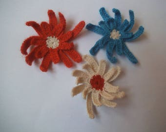 Crocheted blue, off-white and orange flowers