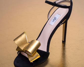 Black high heel sandal with big gold bow