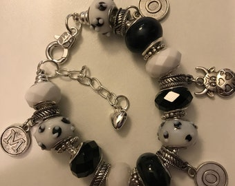Cow themed charm bracelet in black and white