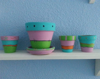 "Hand painted 5 piece clay pot set*Mexican inspired designs.*One 4"" pot with saucer; Three 2 1/2"" pots *Cactus *Succulent* Seedlings*Herbs"