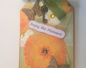 "Handmade Floral Large Dimensional ""Enjoy the Moment"" Pick Me Up Tag with Card Holder on Back  3"" x 4.75"""