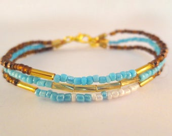 Light blue bracelet - 3 layers beads