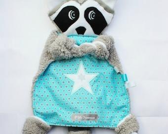 Cuddly plush raccoon.