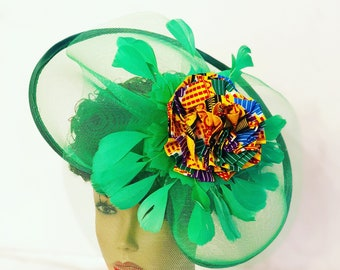 Green Derby African fascinator decorated with kente print fabric feathers and net. Brides and Bridesmaids gift. Mini church hat, Party hat.