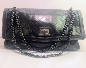 Authentic CHANEL black Large Flap Bag, Shoulder Bag In Classic black Matelasse with Mademoiselle closure