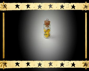 glass vial filled with mini PEAR yellow fimo clay