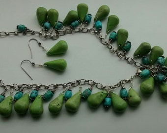 Silver necklace with its turquoise green and blue