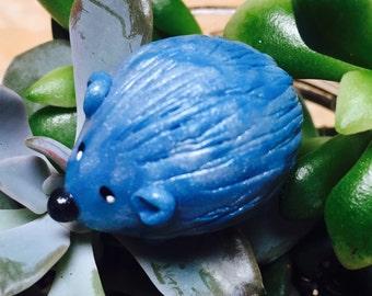 Mini marble Hedgehog of Hedgehog Bog shown  icy blue pearl and icy gray swirl