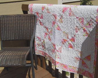 Pink white orange paisley pinwheel quilt