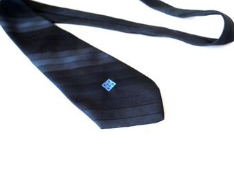 Luxurious vintage 80s dark navy blue polyester necktie with a light blue logo. Made by Givenchy.