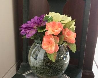 Purple, yellow and orange flowers/round glass vase