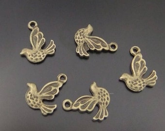 10 charms in antique bronze birds