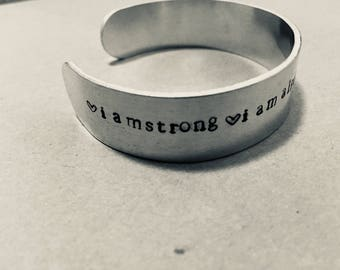 """Hand stamped """"I Am"""" affirmation cuff. I am strong. I am alive. I am fearless. I am unstoppable. Hand stamped cuff. Hand stamped jewelry"""