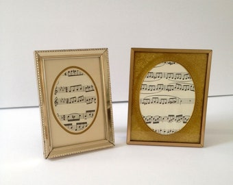 2 vintage Metal Picture Frames with Oval Shape Mattes, inside oval measures 2 1/4 x 3 inch and 2 7/8 x 4 inch images