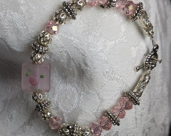Princess:Light  pink glass rondels w/variety of silvertone spacers centered w/square rose bead,silvertone toggle clasp. SimplyElegantKathy