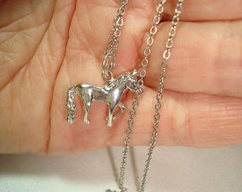 925 Silver Horse Charm on a Silver Tone 16 Inch Chain.
