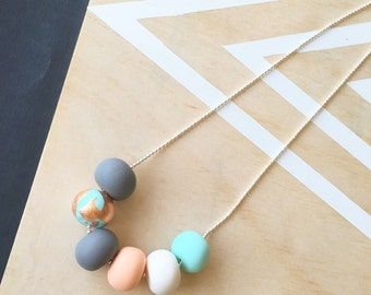 Polymer clay necklace. Mint, copper, peach, white and grey 'the piper'