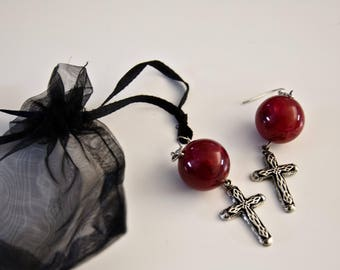 Earrings with round stone and cross-shaped pendant