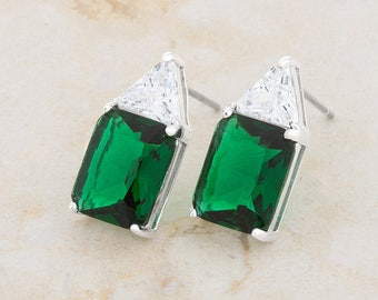 Esmeralda Stud Earrings   A single trillion cut stone accompanies an emerald radiant cut stone in these elegant 8ct CZ silver studs.