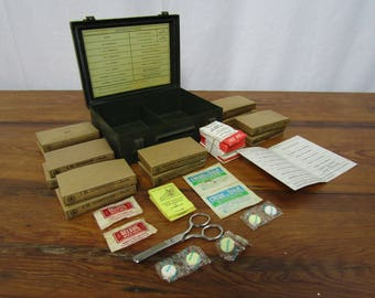 Bell Systems First Aid Kit partially full with extras