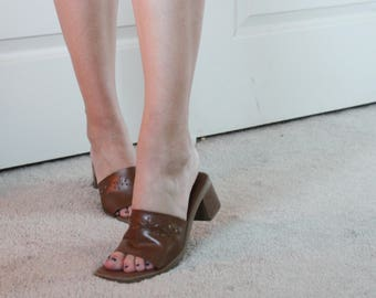Vintage flower cut-out brown faux leather Montego Bay Club mules size 6 with square toe.