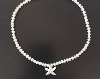 Pearl necklace with starfish drop