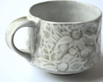 Cup with Australian Flannel Flower design - White and buff stoneware ceramic cup