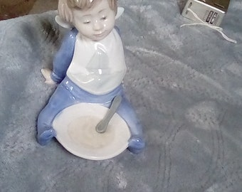 Lladro toddler with plate and spoon