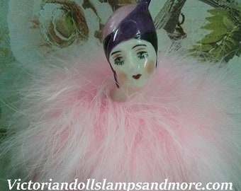 Powder Puff Porcelain Pierette Doll with light pink boa