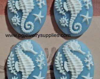 25mm x 18mm oval resin seahorse cameos white on blue sea horses 4 pieces lot l