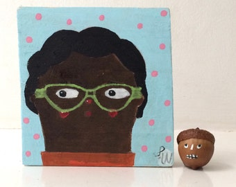 Painting on reclaimed wood of a lady with mint spectacles