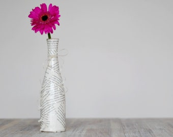 Unique boudoir vase crafted with the pages of a racy adult novel