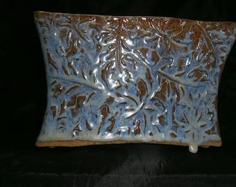 Opal blue rectangular vase.