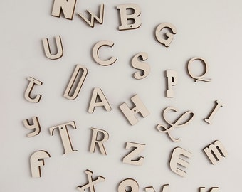 Alpha-Bits are 66 magnetised laser cut letters . Two full alphabets + the 13 most commonly used letters means you can actually write words.