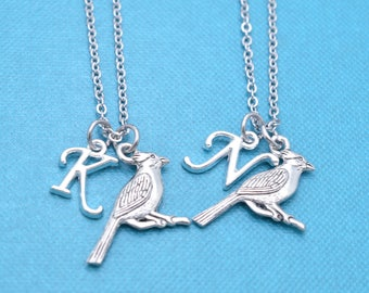 Two Cardinal necklaces in silver pewter.  Best friend necklaces.  Mother Daughter. Cardinal necklaces.  Bereavement Gifts.