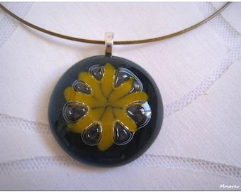 "Round fusing ""glass flower"" pendant. Gray-blue and orange tones"