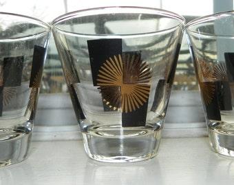 Vintage Set of 3 Mid Century Atomic Age Black and Gold Sun/Star Burst Shot Glasses